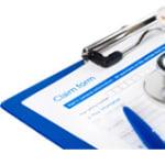 closeup insurance claim form on a clipboard