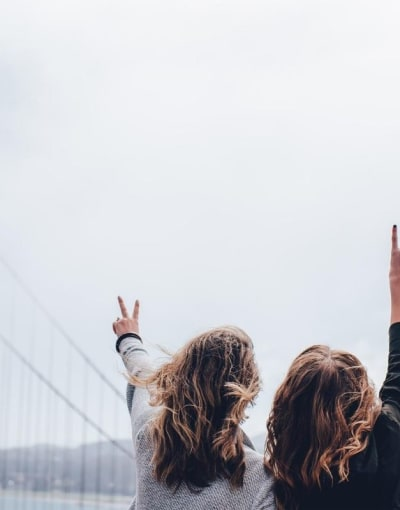 Tourists posing in front of the iconic Golden Gate Bridge while on a tour of the best of San Francisco