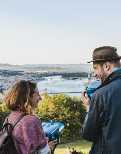 Tourists enjoying the picturesque views of Budapest from a lookout point