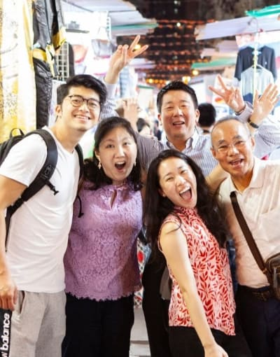 Local guide touring the night markets of Hong Kong with a group of tourists