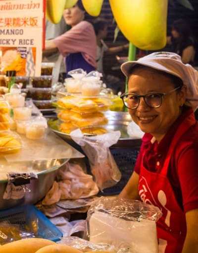Local street food vendor at a food market in Bangkok