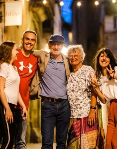 Tourists enjoying a night tour of Barcelona with a local guide