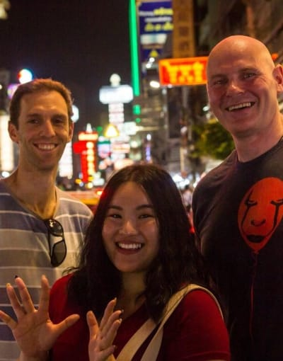 Tourists posing with their local guide on a night tour of Bangkok's Chinatown
