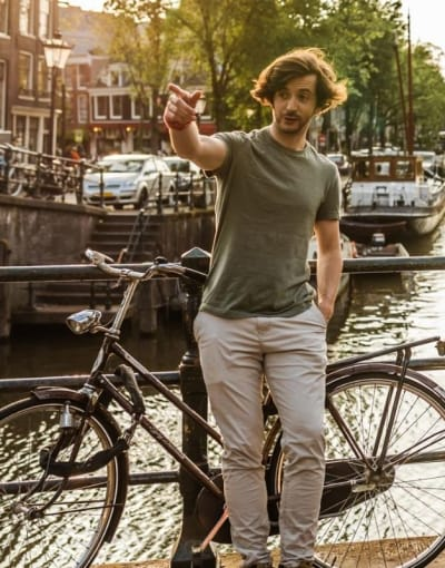 Local guide showing a tourist around Amsterdam on a sunny day