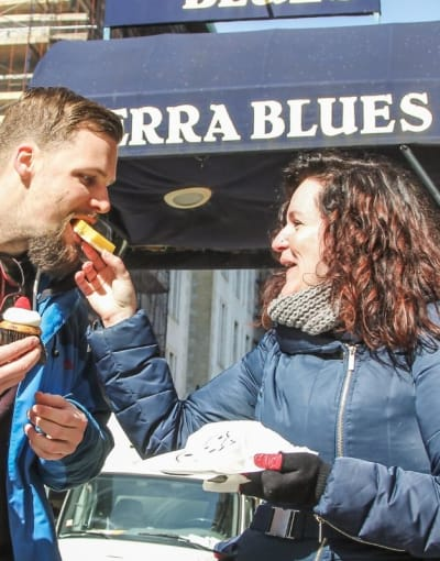 Tourists trying local food on a food tour of Greenwich Village