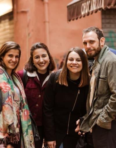 Group of tourists exploring Mercato di Mezzo in Bologna