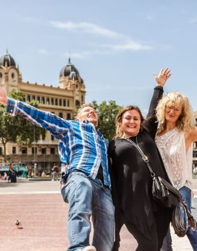 Tourists exploring Barcelona with a local guide