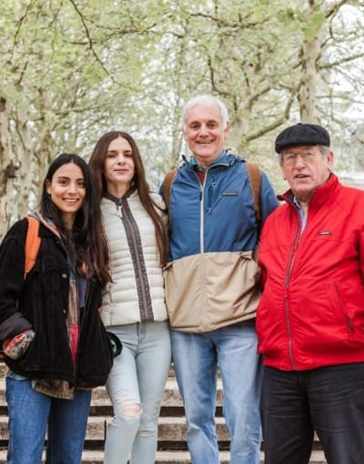 Group of tourists posing with their local guide after a tour of Hamburg's hidden gems