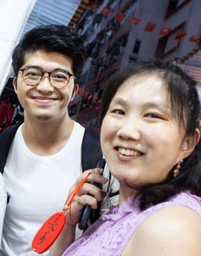 Tourists enjoying a night tour of Hong Kong with a local guide