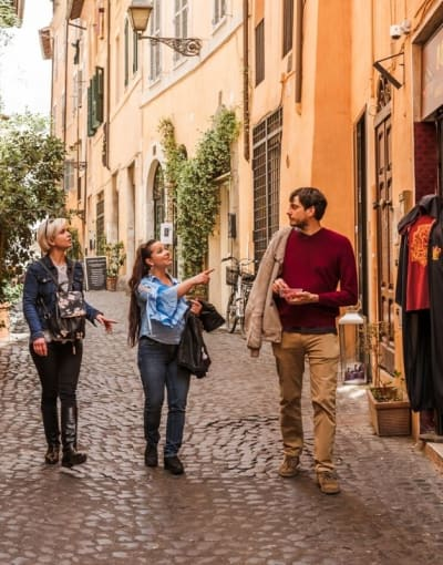 Tourists exploring the cobblestone streets of Rome with a local guide