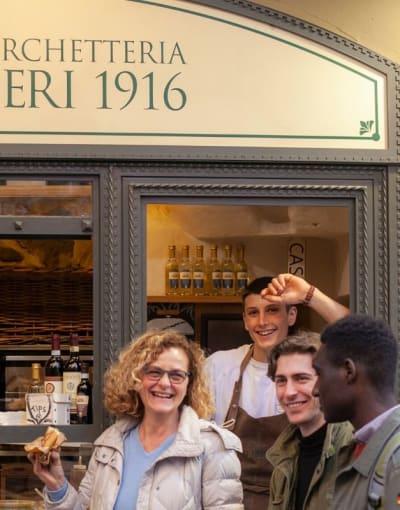 Tourists exploring the food scene of Florence with a local guide