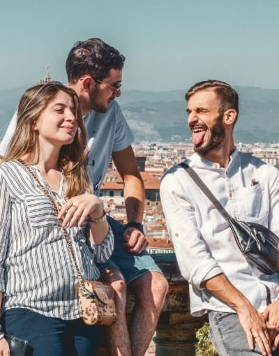 Tourists standing in the sunshine with their local guide at a viewpoint in Florence