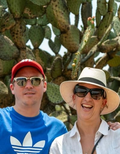 Tourists posing in front of huge cactuses in Mexico City