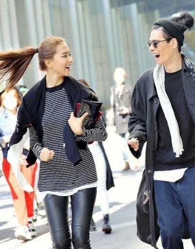 Trendy locals walking along a busy street in Seoul