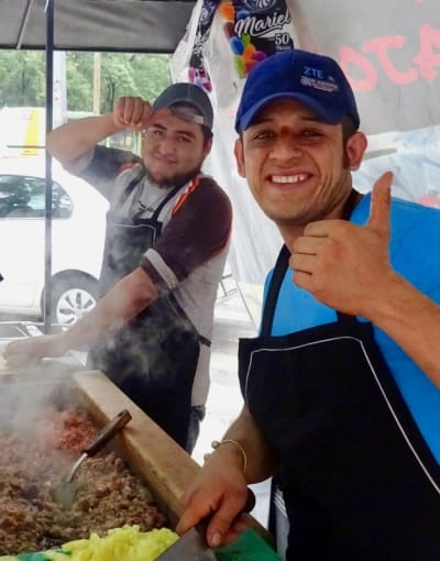 Locals cooking at a street food stall in Mexico City