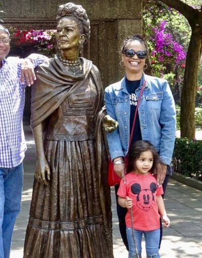 Tourists posing with bronze statues in a beautiful park in Mexico City