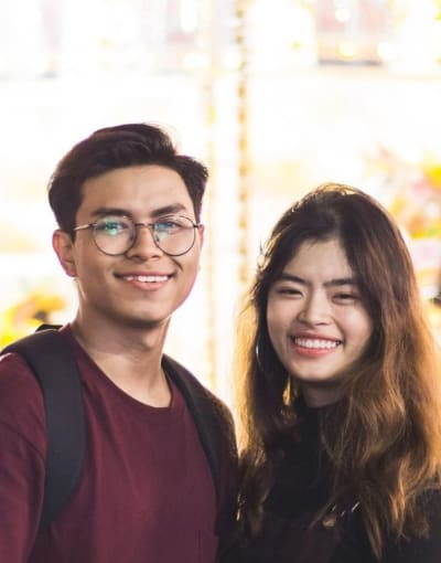 Couple posing in front of a fair ride in Singapore
