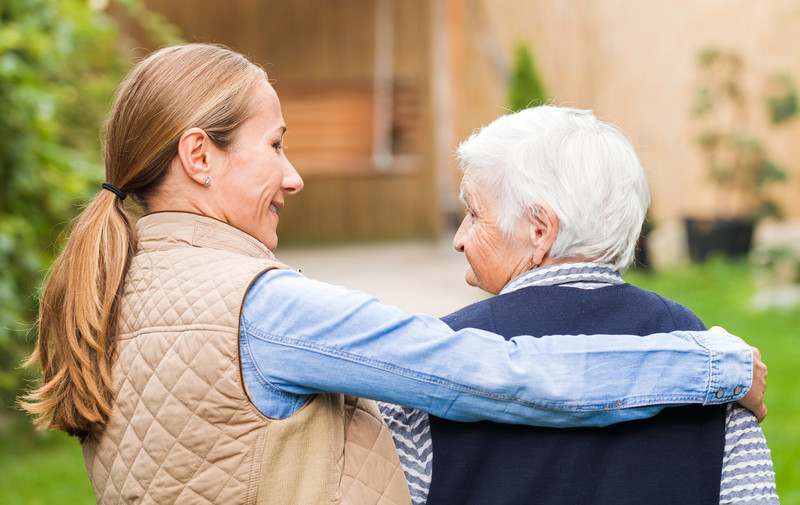 An in home care provider walks with a senior in North Augusta, SC