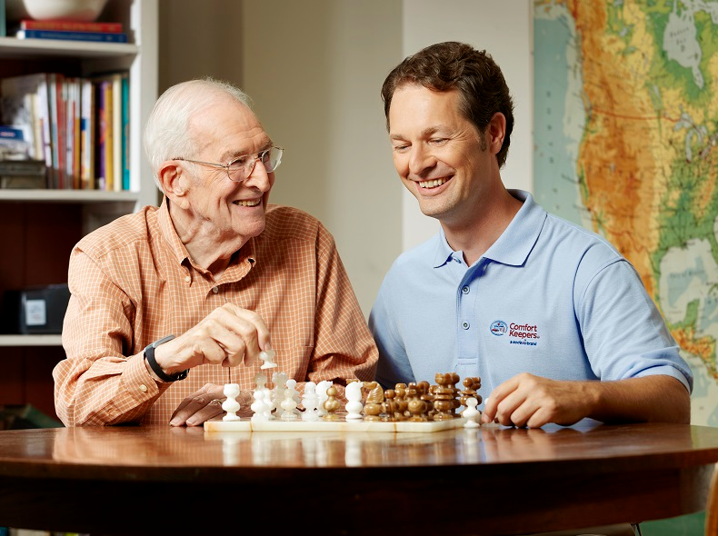 A 24 hour home care provider playing chess with a senior man in Snyder, TX