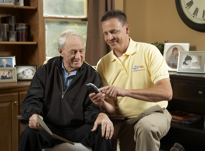 A care at home provider assists a senior man in Snyder, TX