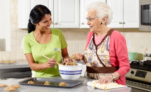 A home care services provider cooking with a senior in China Grove, NC