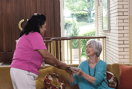 Elderly Houston woman with a senior companion in her home