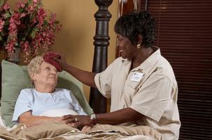 Caregiver Providing Palliative Care at Home