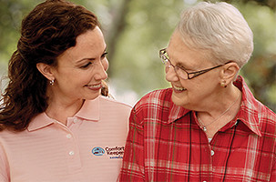 Caregiver Assisting with Medication Management