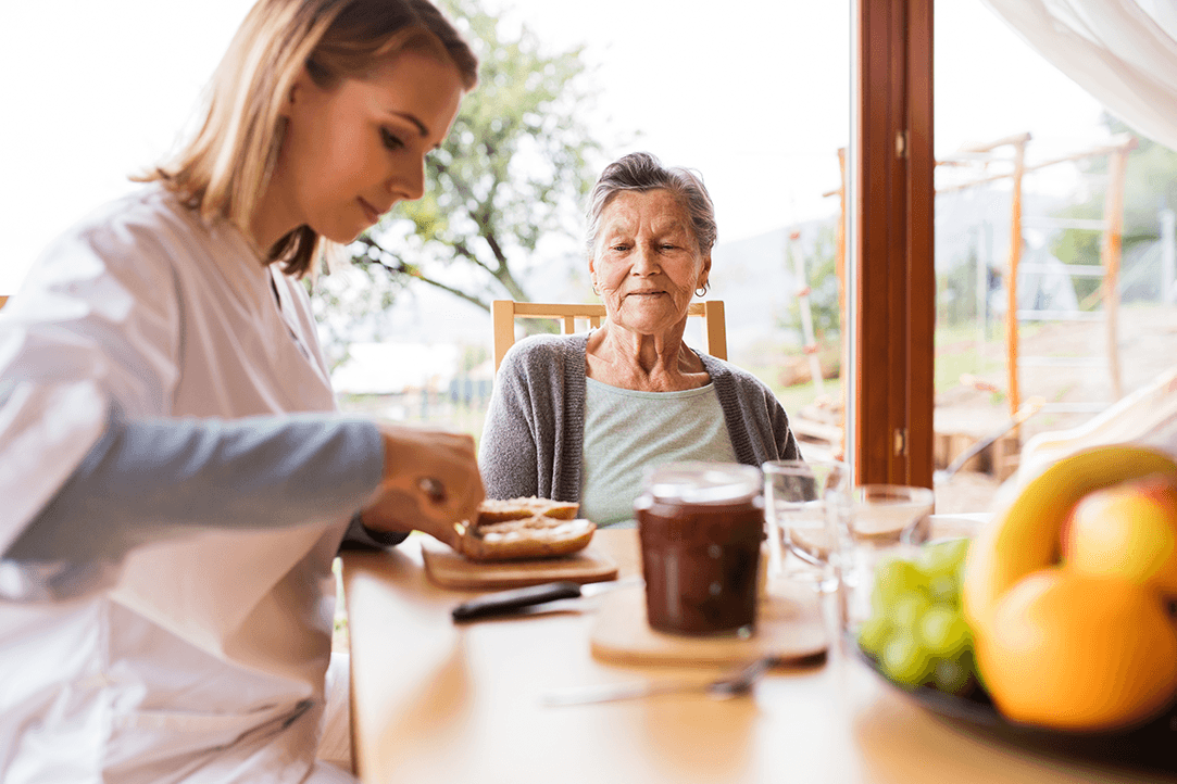 Caregiver and a senior woman during a home visit.