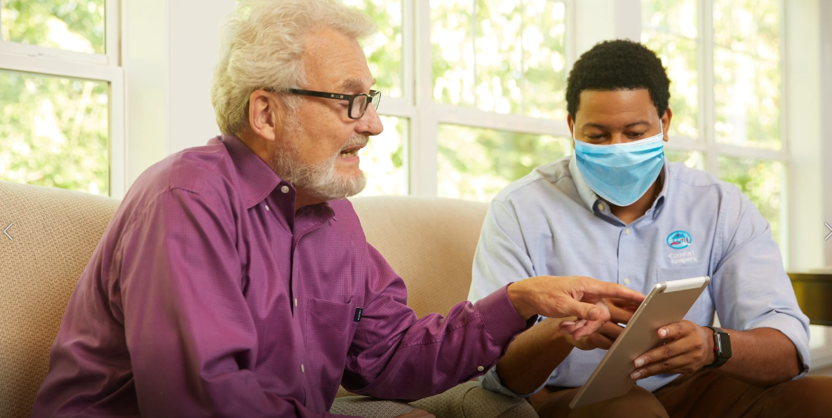 senior and caregiver with ppe in san diego