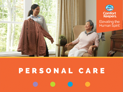 Comfort Keepers Home Care Graphic for Personal Care Services - shows a caregiver holding up clothes to help senior client pick what to wear
