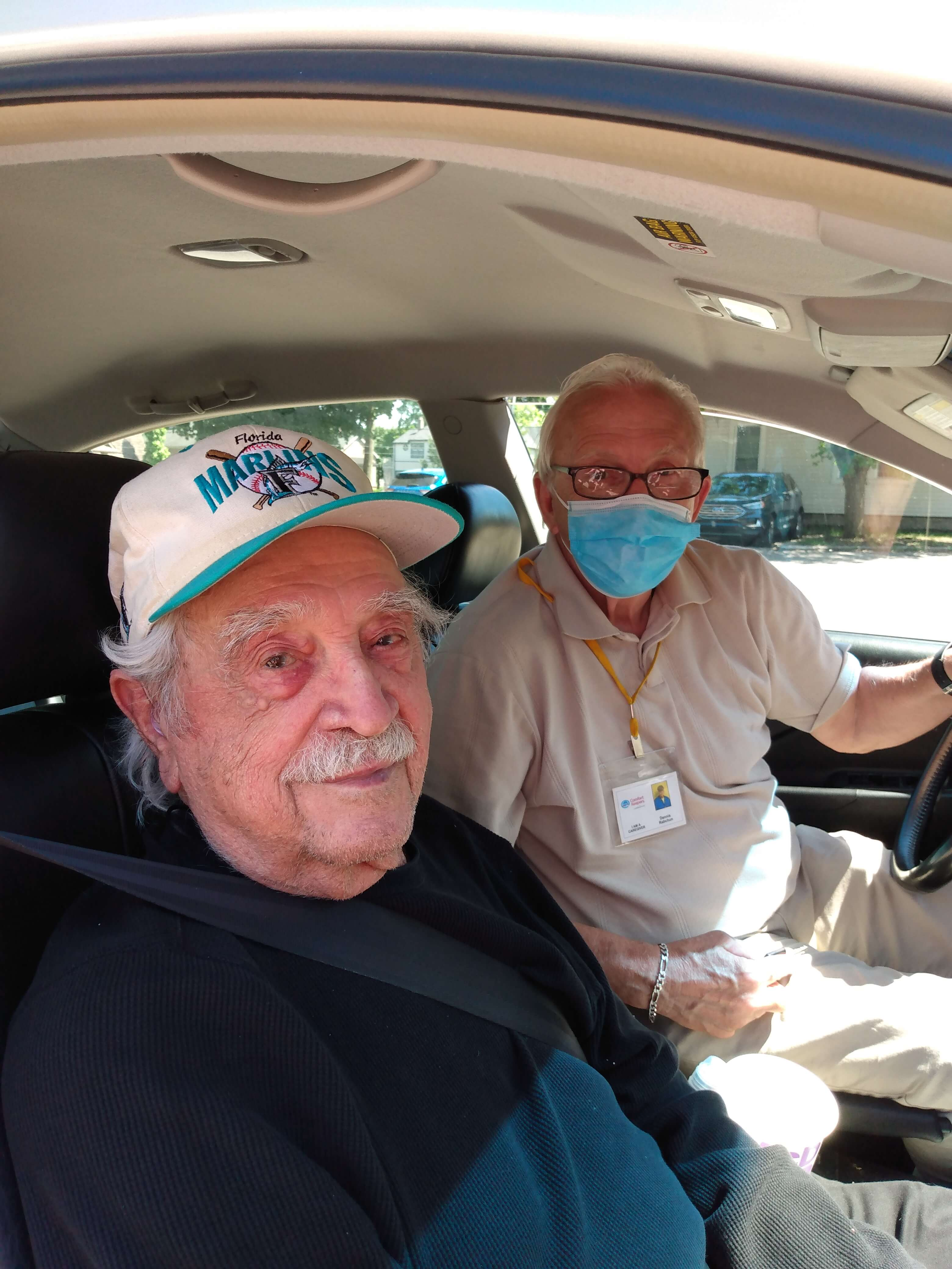 Photo of caregiver and senior client in car