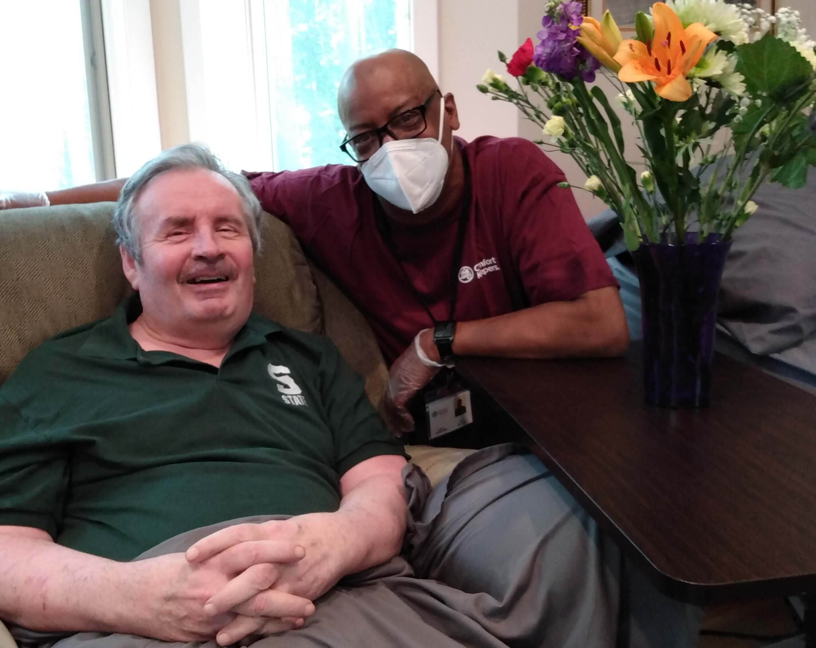 Caregiver and senior client in client's home