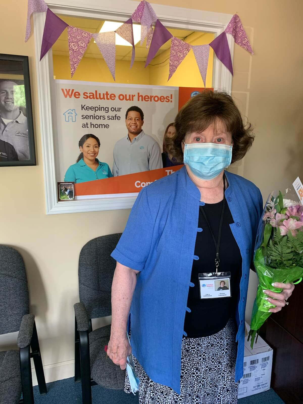 Photo of caregiver wearing a mask in the Comfort Keepers office