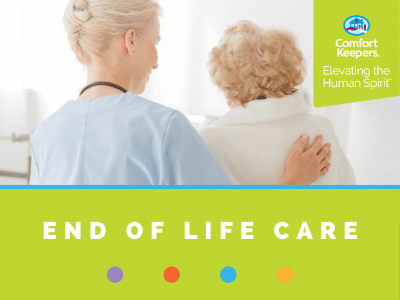Comfort Keepers Home Care Graphic for End of Life Care - photo of caregiver comforting senior, they are facing away from the camera.