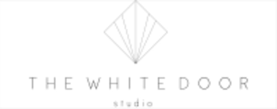 The White Door Studio logo