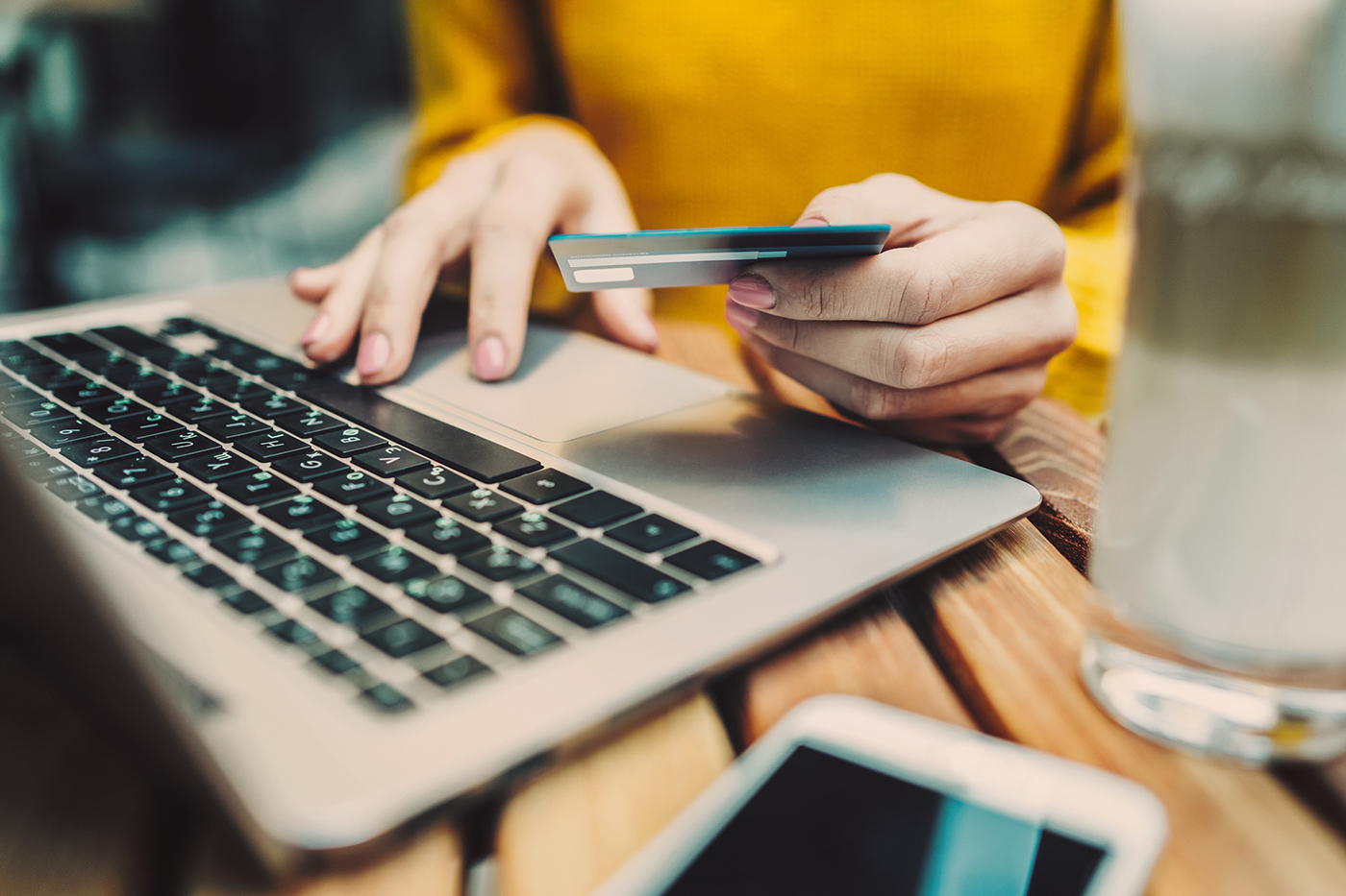 woman using credit card to make online purchase