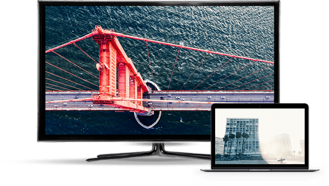 tv and laptop with image of bridge