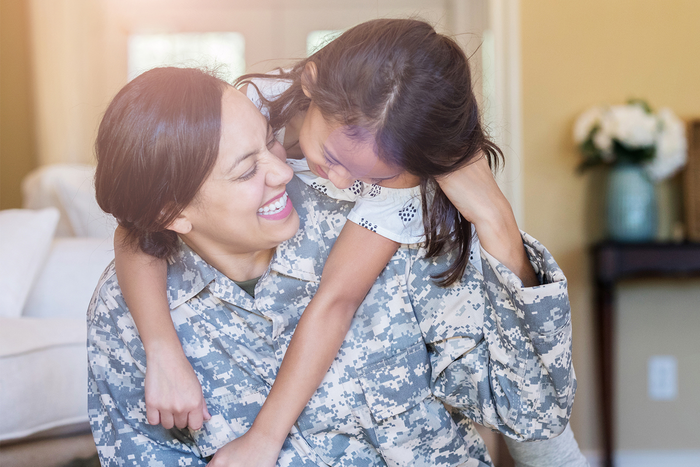 military mom smiling at daughter