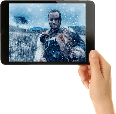 hand holding tablet with movie streaming