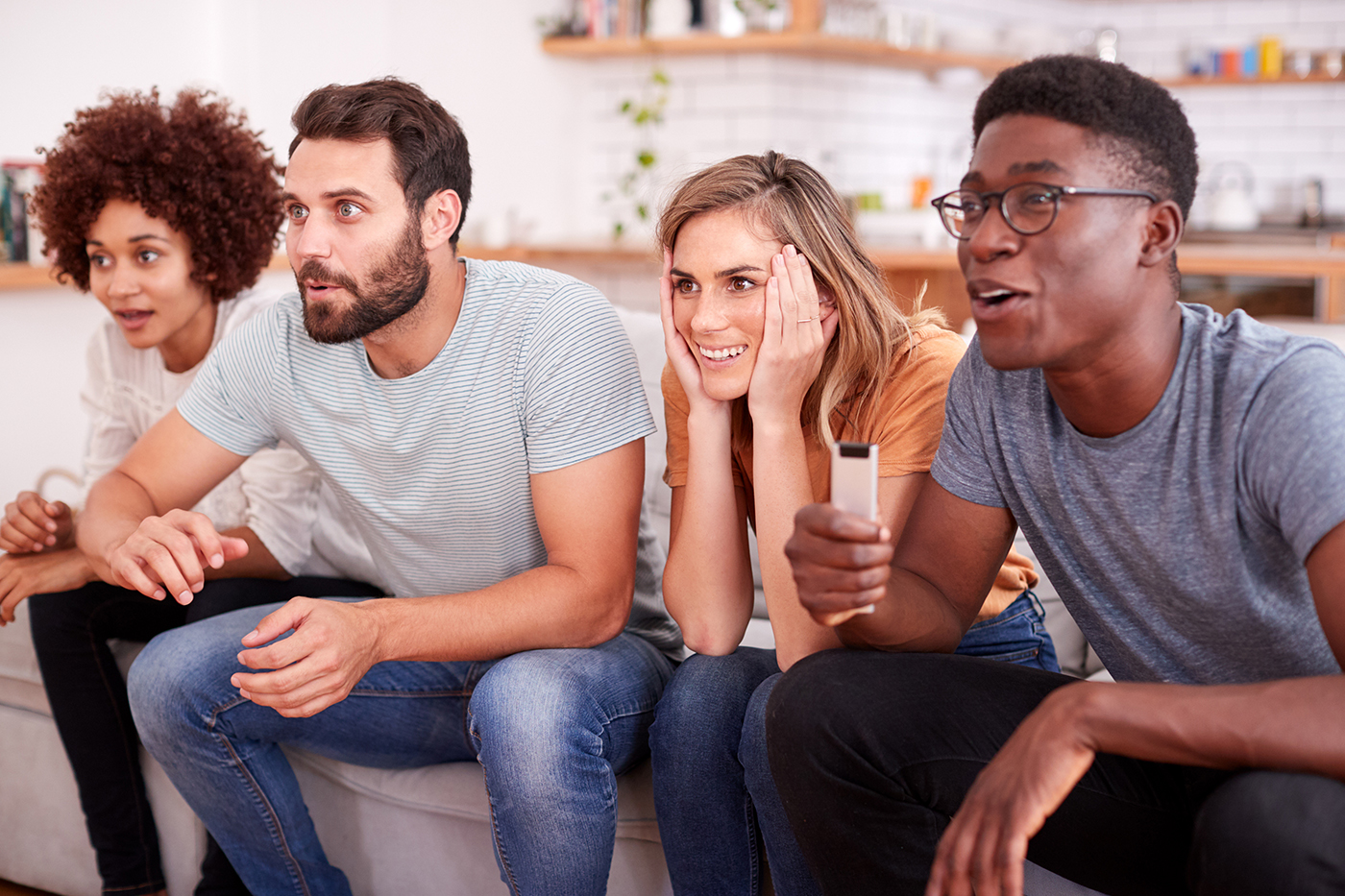 friends watching intense game on tv