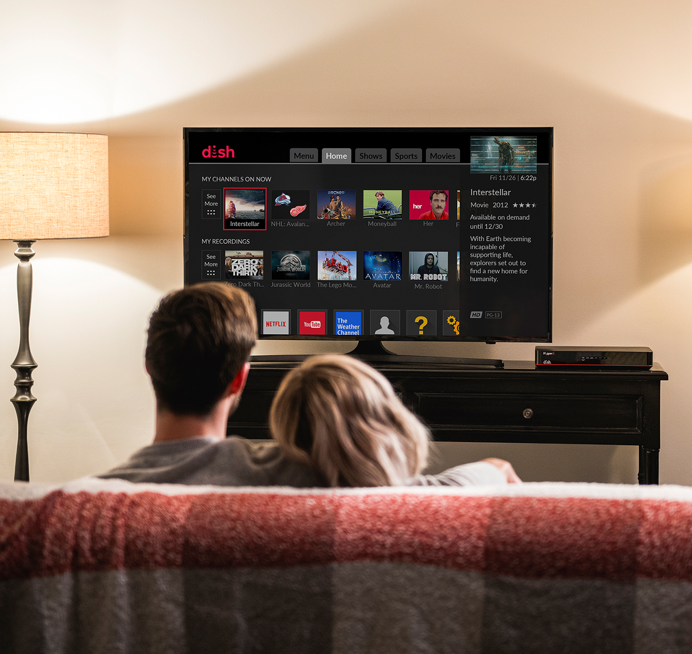 couple snuggled on couch watching media from DISH hopper dvr