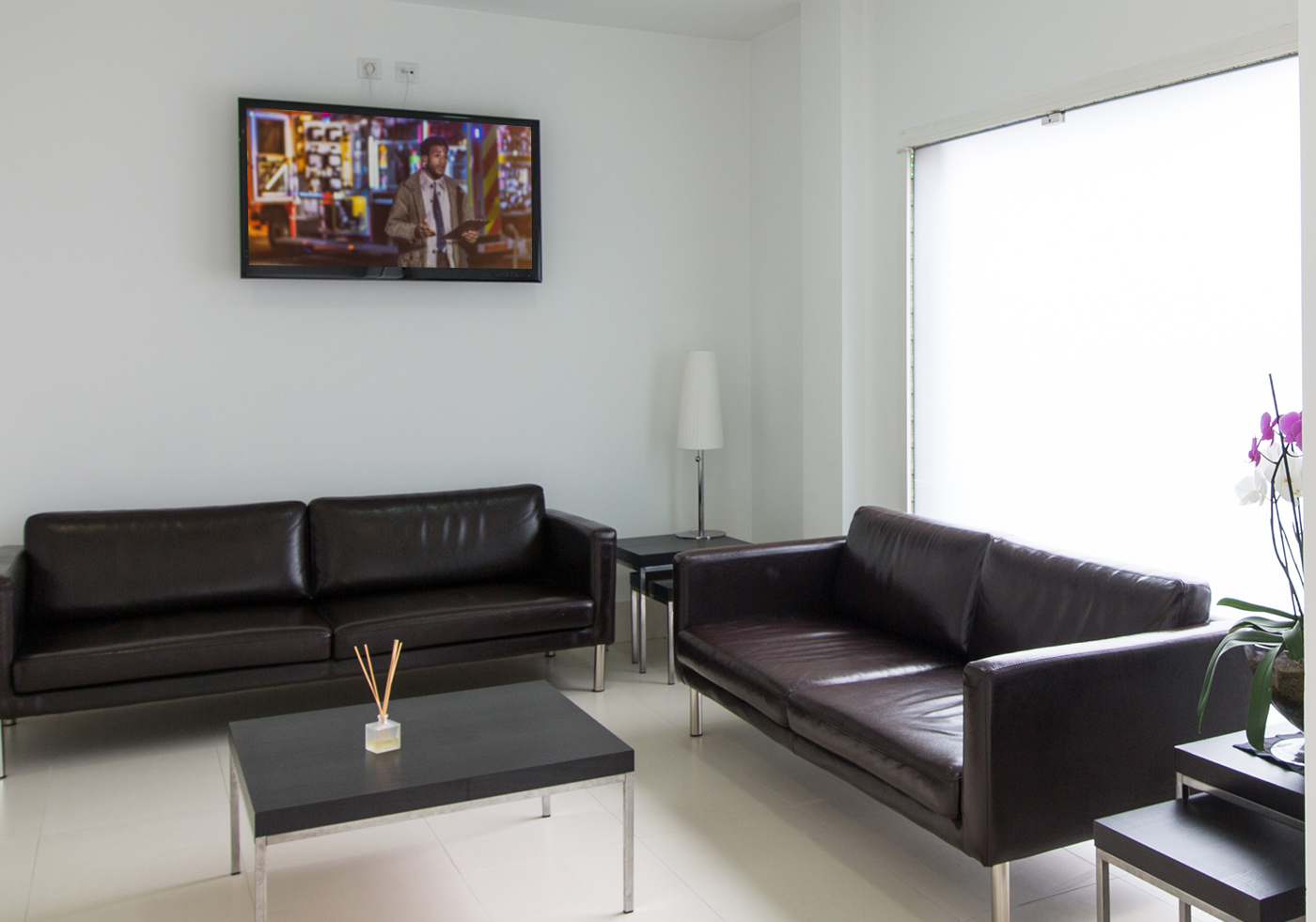 office waiting room with mounted tv on wall
