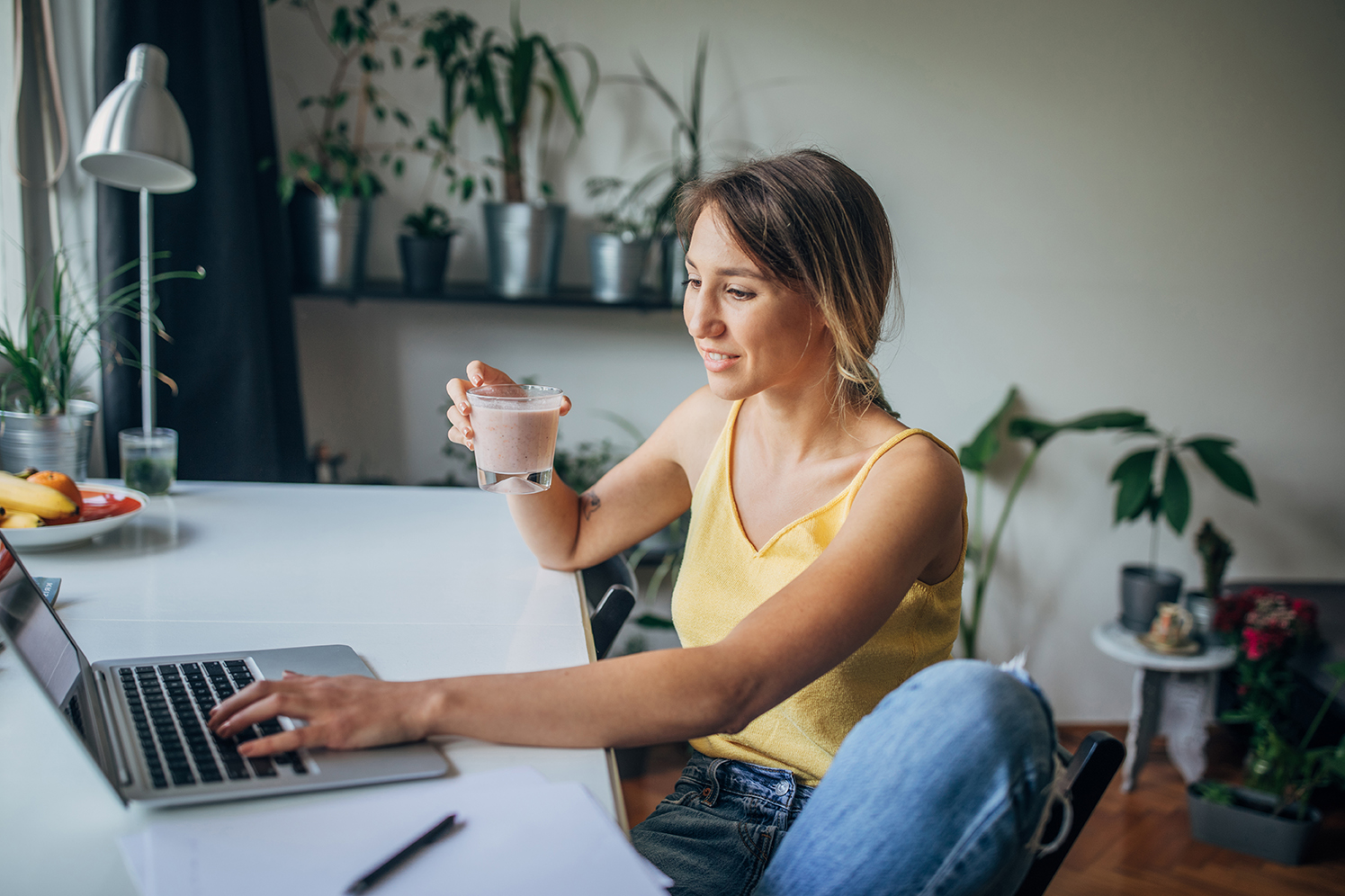 woman at table using laptop