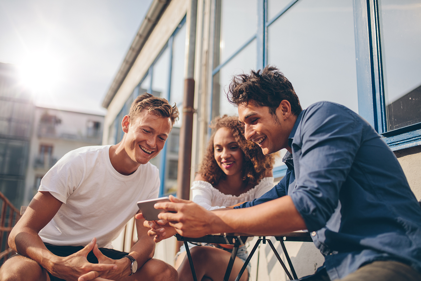 Group of friends watching tv on phone