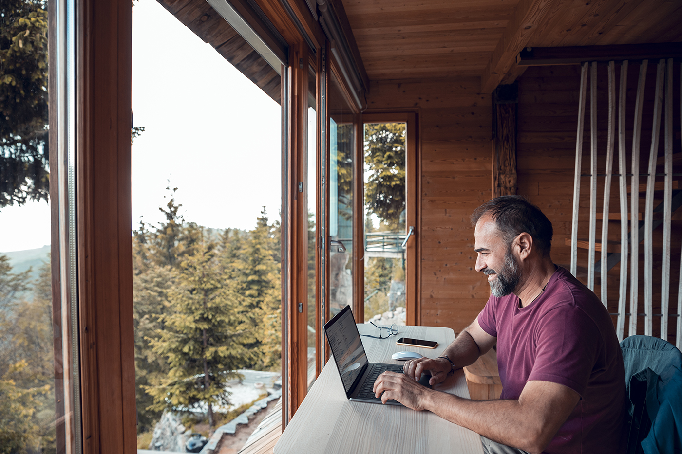 man using internet on laptop in rural location