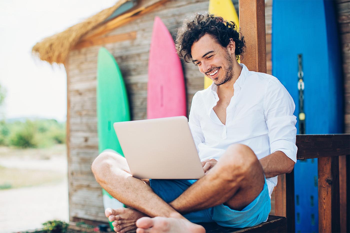 Man using laptop at remote island residence