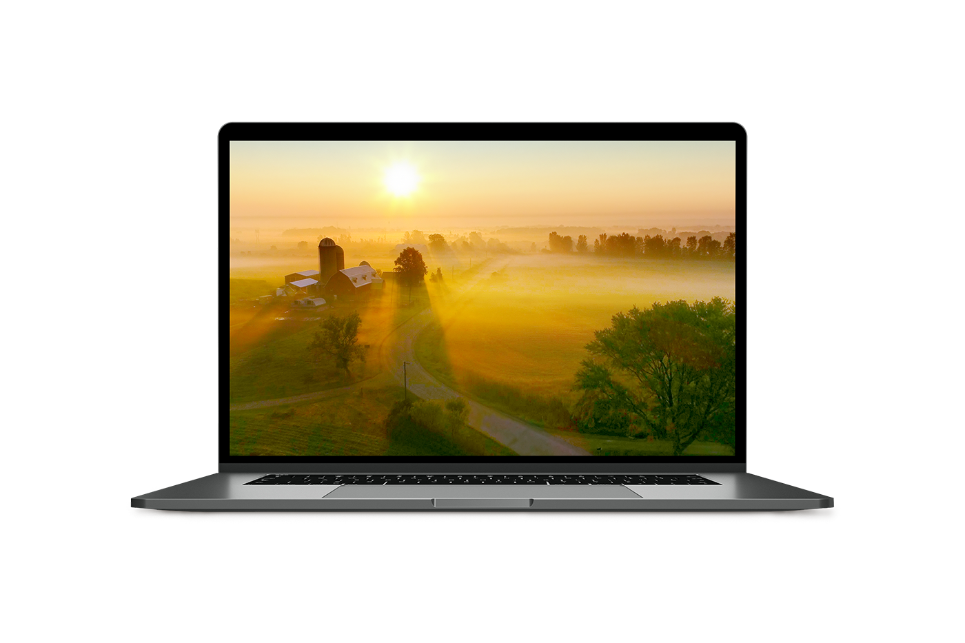 laptop with an image of a farm at sunset