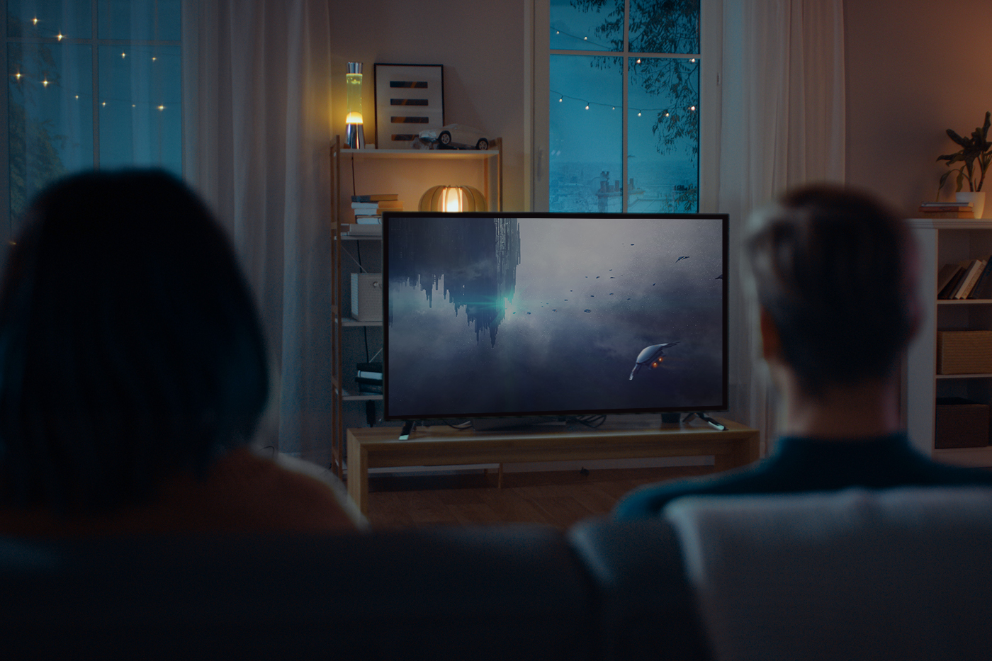 couple on couch watching sci-fi movie