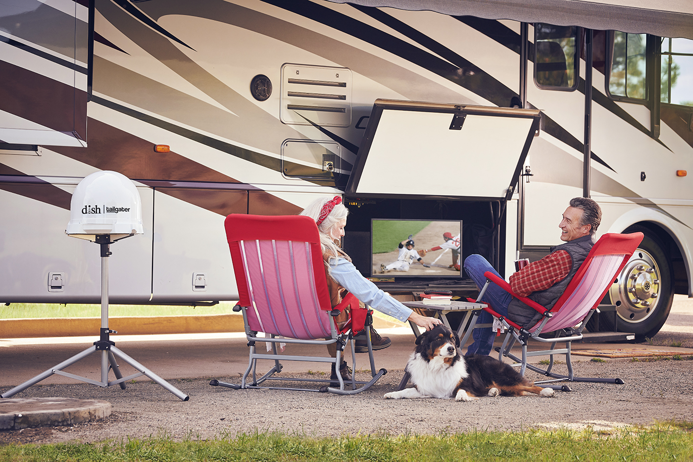 couple watching tv outside their RV